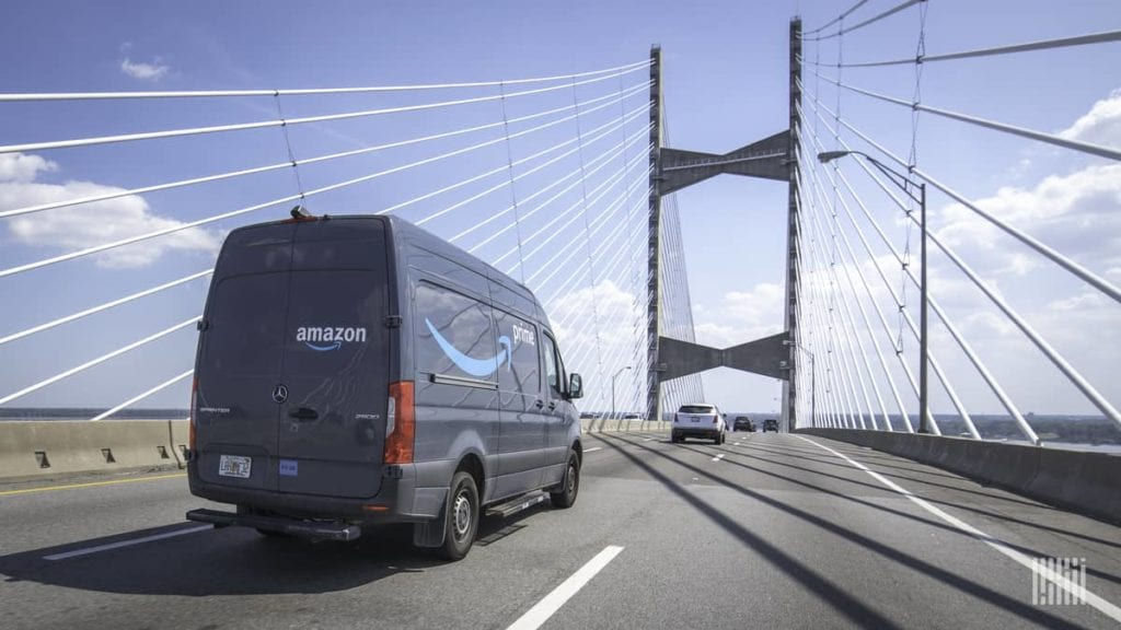 amazon delivery truck on bridge
